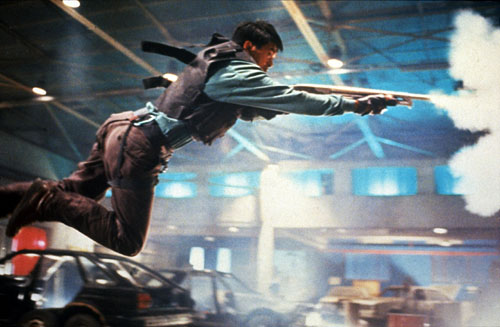 Chow Yun-fat executes a gun-fu move