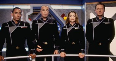 Dr. Franklin, Security Chief Garibaldi, Commander Ivanova, and Captain Sheridan