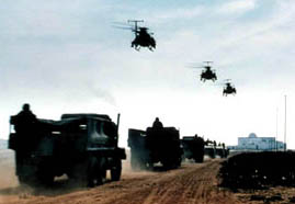 Helicopters and a humvee convoy head into Mogadishu
