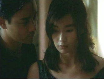 Leslie Cheung and Maggie Cheung pass some time in Days of Being Wild